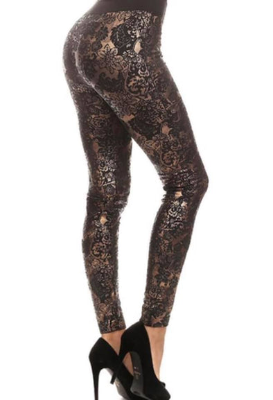 Women's black fashion legging with gold metallic outlining and floral print.  OS legging-