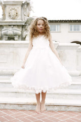 Flower girl dress with  cross shirred bodice and knee length floral pom pom detail at waist and hem.(FG2949)