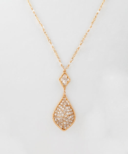 14k gold fill necklace finished with Swarovski crystal pendant. (AC7540)