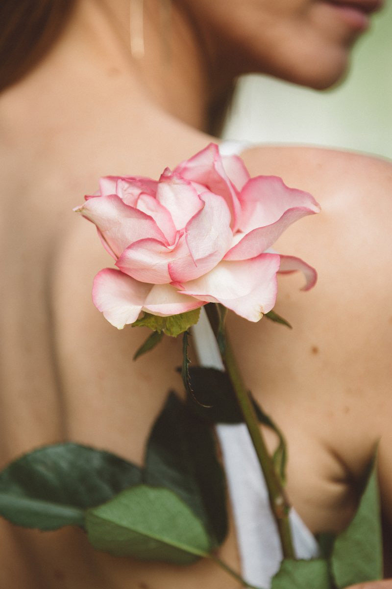 woman with flower on back