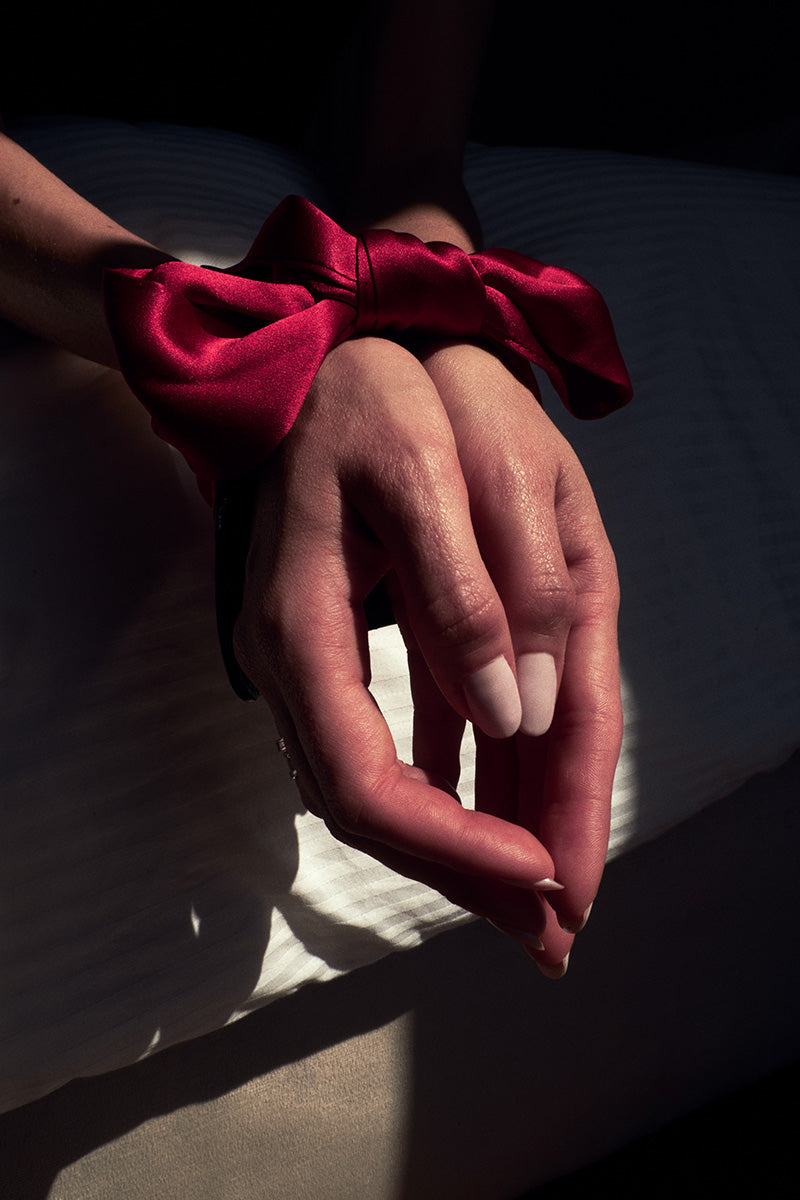 red bow around hands