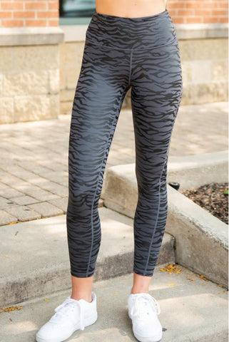 Leggings negros de yoga con estampado de cebra