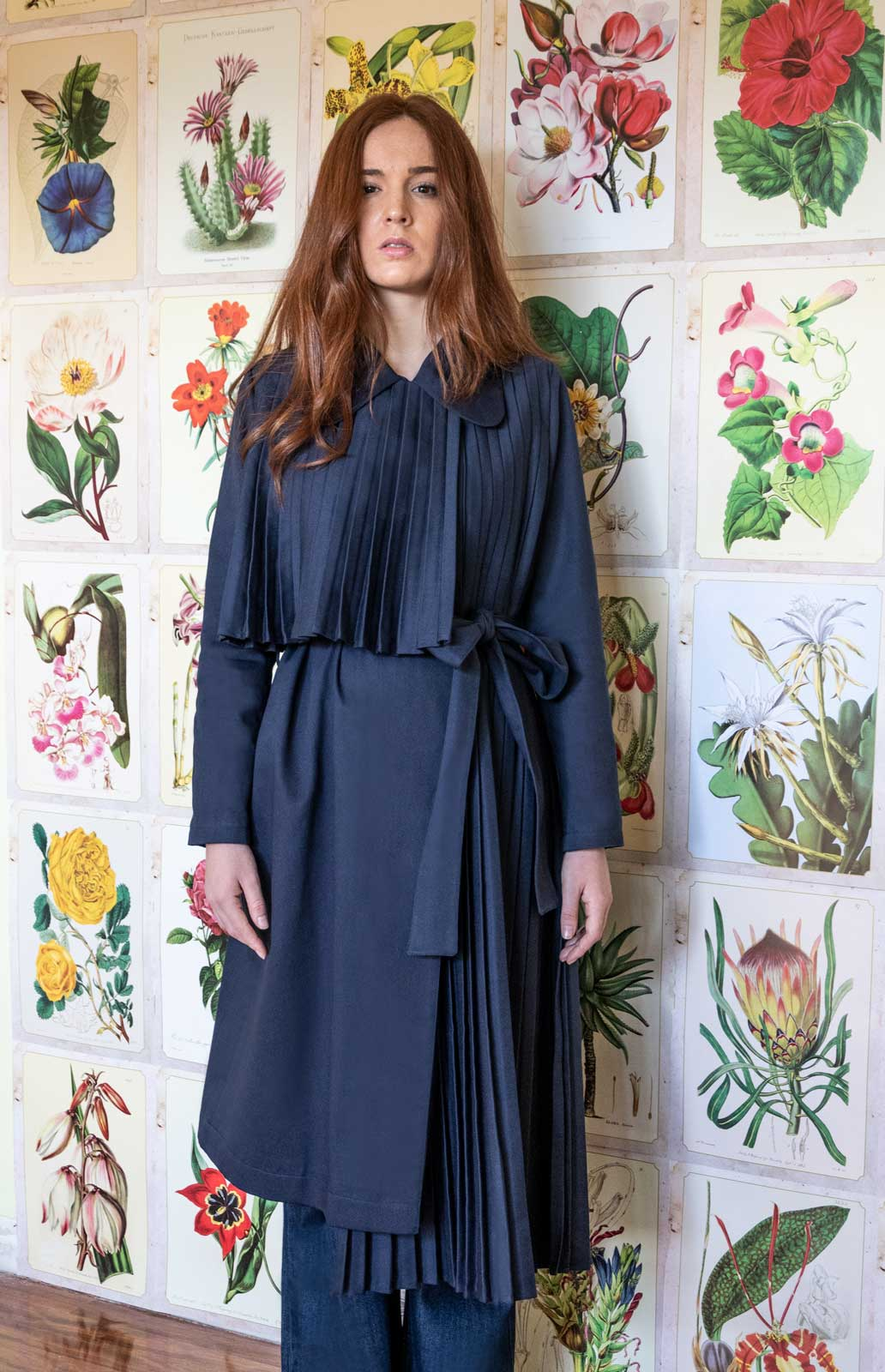 Asymmetric navy pleated trench