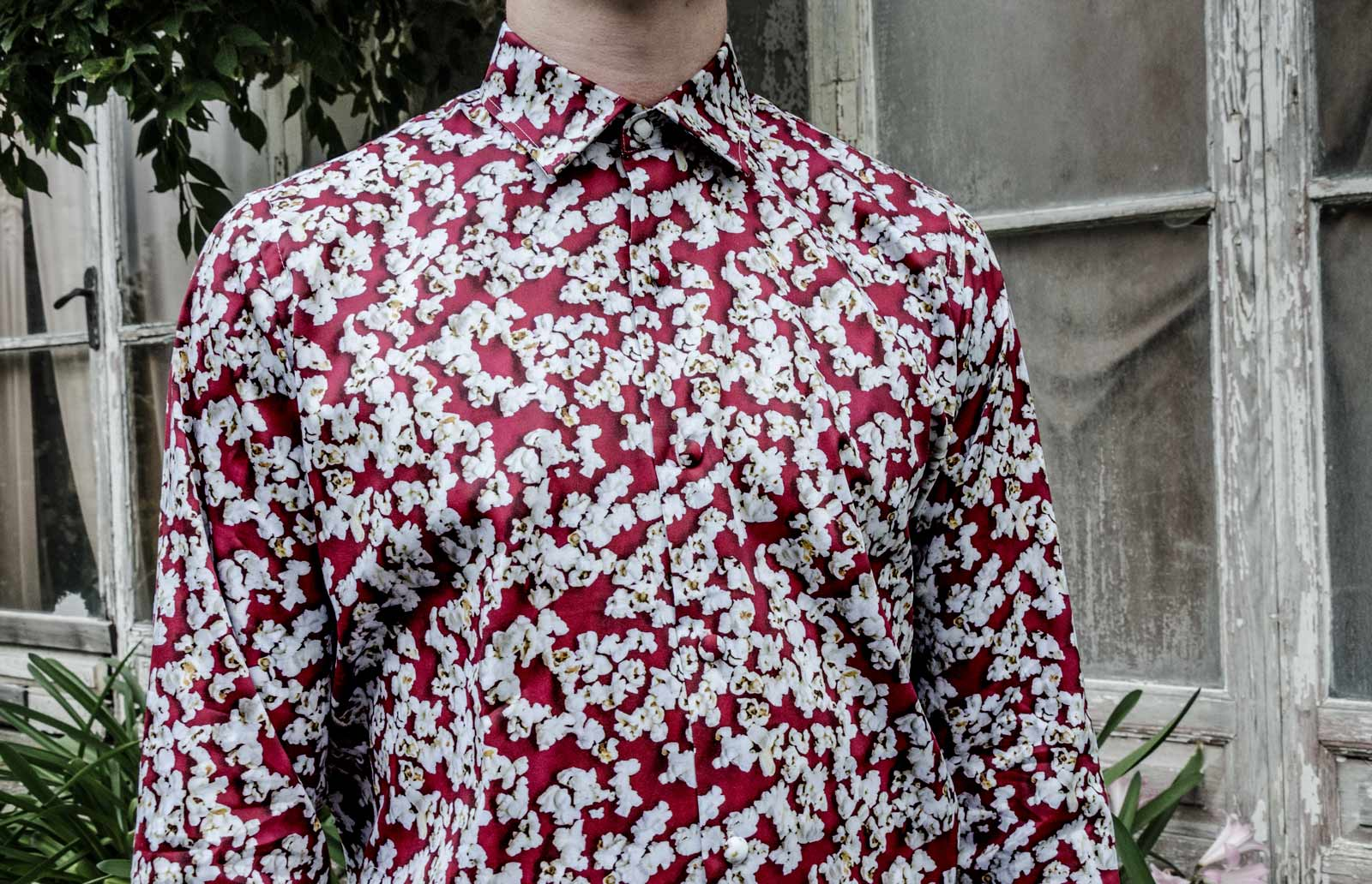 Red popcorn shirt man