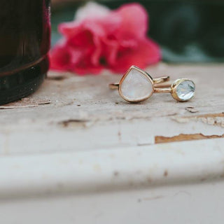 wings hawaii handcrafted ring with teardrop shaped rainbow moonstone bezel set in 14 karat yellow gold