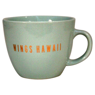 teal mug with wings hawaii graphic in gold