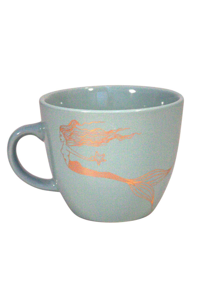 gold mermaid holding a starfish graphic on a teal mug