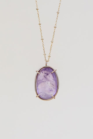 smooth amethyst crystal in a gold filled prong setting necklace on a satellite chain