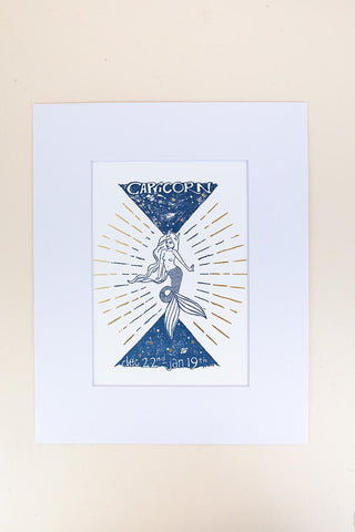 capricorn mermaid zodiac print with mat blue and gold wings hawaii