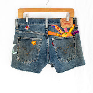 levi denim shorts with sun, moon and stars patched on from vintage aloha fabrics