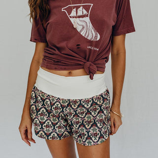 model wearing distressed graphic tee shirt with vintage flower pattern lounge shirts with soft waistband