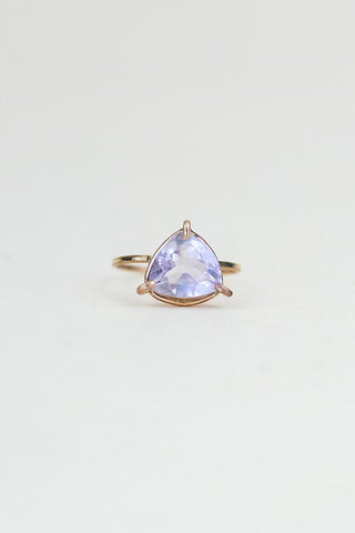 faceted amethyst crystal in a prong setting gold fill ring