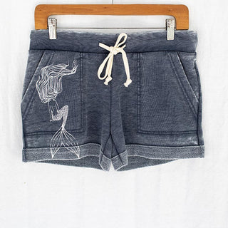 navy shorts with pockets, drawstring and white mermaid graphic on left pocket