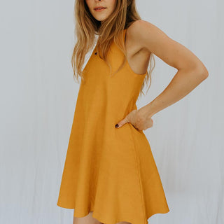 model wearing ribbed high neck dress in marigold yellow color