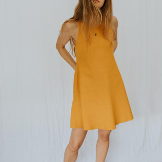 model wearing yellow ribbed mid length dress