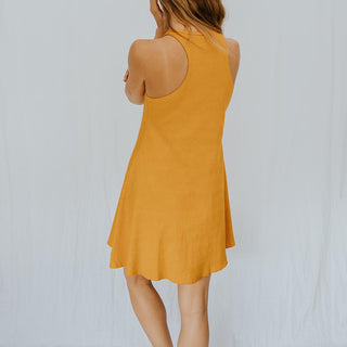model wearing marigold dress