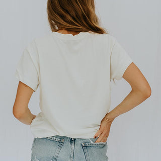 back view of model wearing white tee shirt and denim shorts