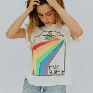 model wearing white tee shirt with the words pink floyd and a rainbow graphic