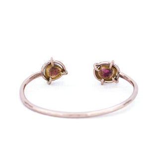 wings hawaii cuff with prong set watermelon tourmaline slices on each end on 14 karat gold fill