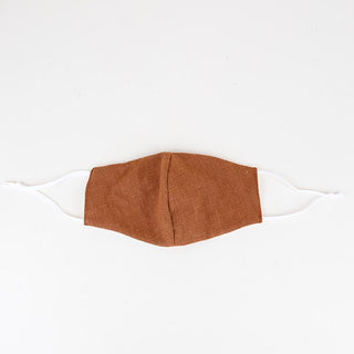 linen face mask in rust color with white ear straps