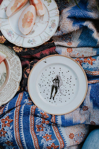 vintage plates with artwork, we are made of stardust woman and stars