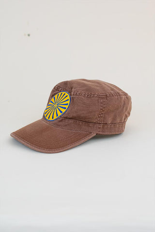 yellow and blue sun and moon graphic patch on a brown military style cap womens hat summer haiku maui wings hawaii accessories