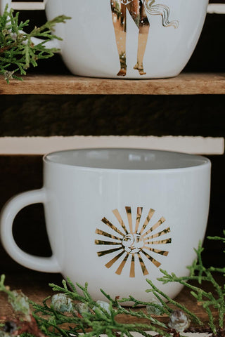 sun and moon gold decal on a white ceramic mug wings hawaii