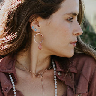model wearing hoop earring with sunstone crystal, crystal necklaces and opal stud earrings