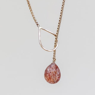lariat necklace made with gold filled materials and a sunstone crystal on the end