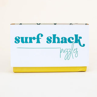 surf shack puzzle A super fun puzzle made of premium 100% recycled Eska board. Printed with non-toxic inks and a matte finish. Art by illustrator Kim Sielbeck based in Hawai'i.