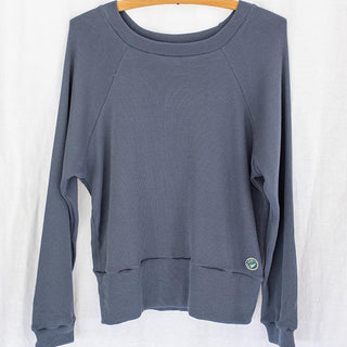 front view of long sleeve raglan style sweater