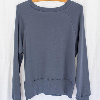 back view of long sleeve raglan sweater in blue