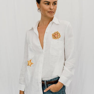 sun and moon 100% linen blouse white with aloha fabric patchwork on the back stars and sunset sunrise shapes button up long sleeve women's top casual and chic hand sewn haiku maui wings hawaii
