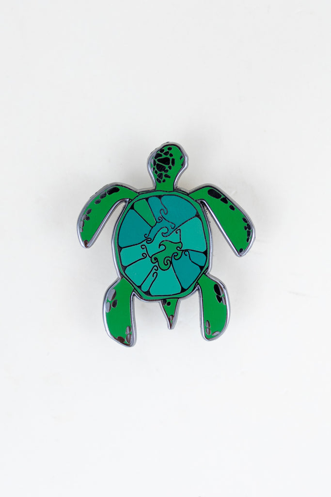 enameled pin of a green sea turtle