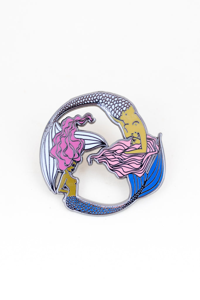 enameled pin of two mermaids. pisces symbol
