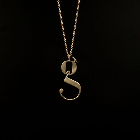 Gold Lowercase g necklace Designed by Moshik Nadav Typography with Paris Pro Typeface
