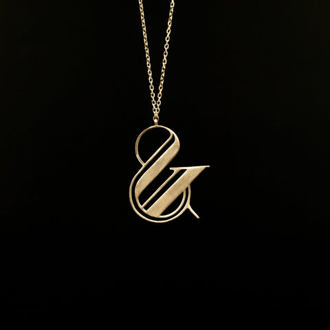 gold ampersand necklace by Moshik Nadav Typography