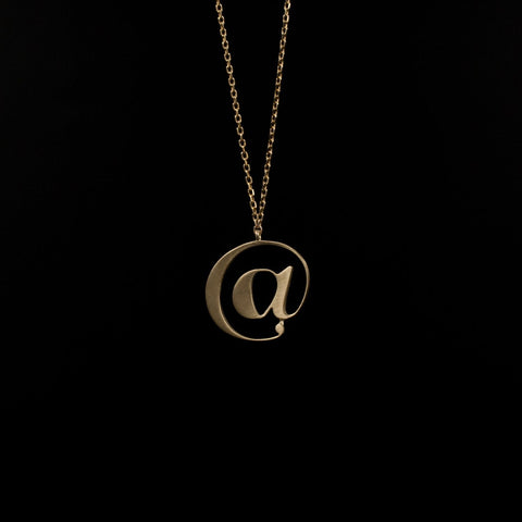 Gold @ necklace by Moshik Nadav Typography