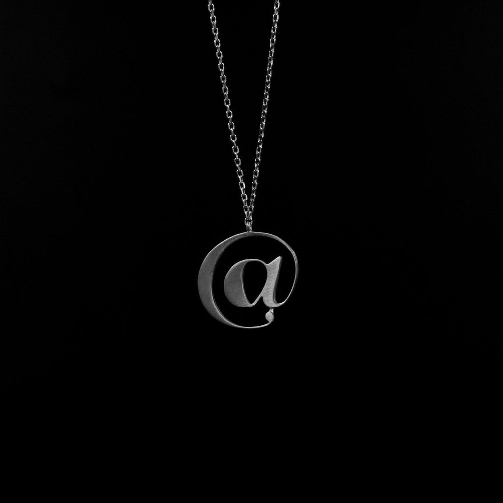 Silver @ necklace by Moshik Nadav Typography
