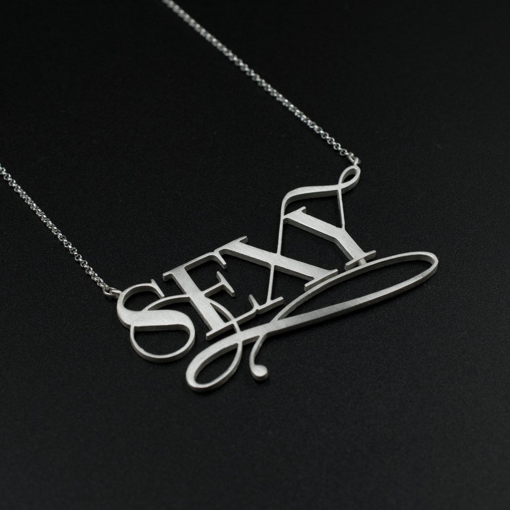 Beautiful silver sexy necklace by Moshik Nadav Typography