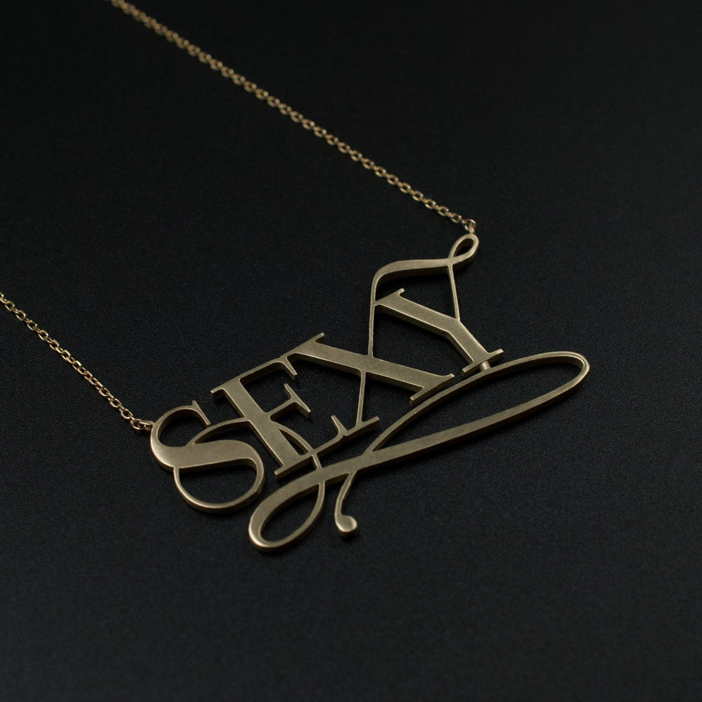 Beautiful gold sexy necklace by Moshik Nadav Typography