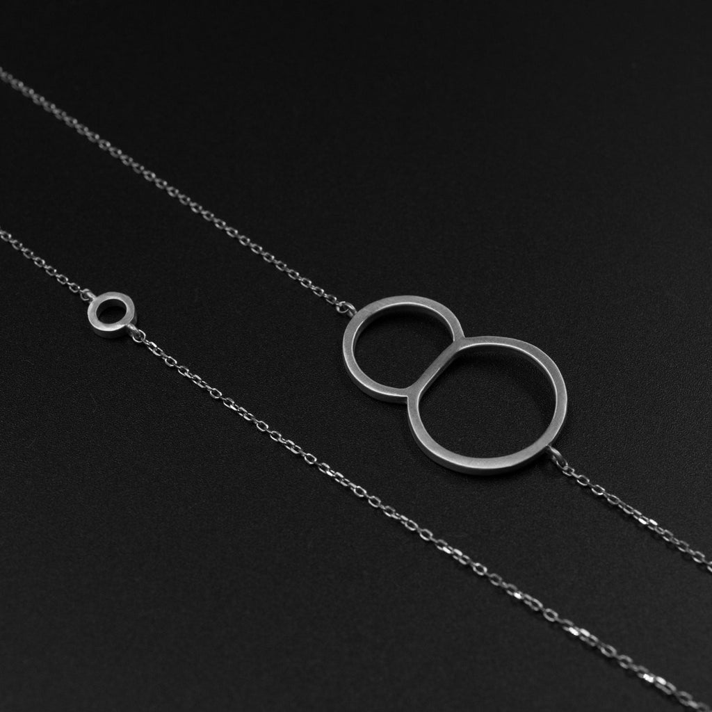 Silver 8 necklace by Designed by Moshik Nadav Typography with Paris Pro Light Typeface