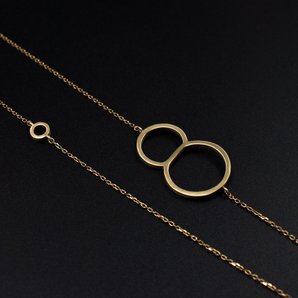 Gold 8 necklace by Designed by Moshik Nadav Typography with Paris Pro Light Typeface