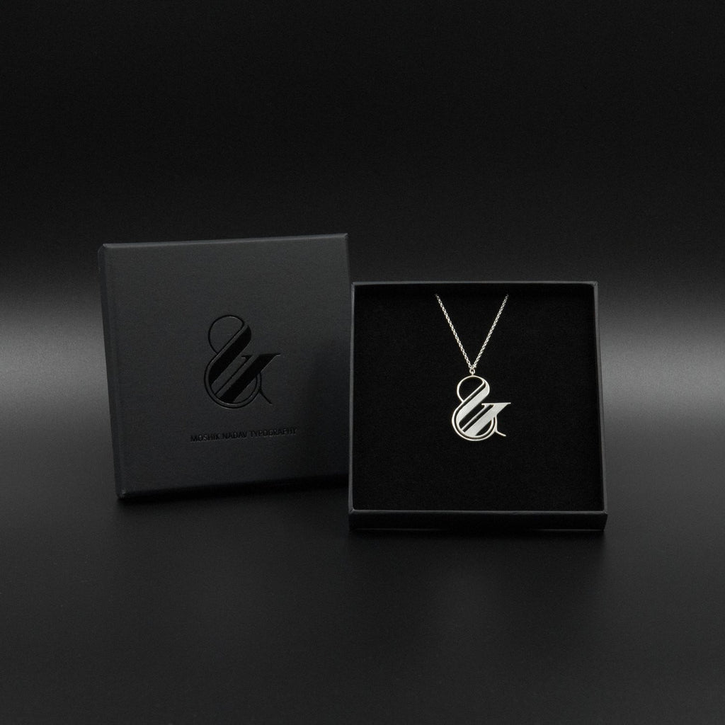 Beautiful silver ampersand box necklace by Moshik Nadav Typography
