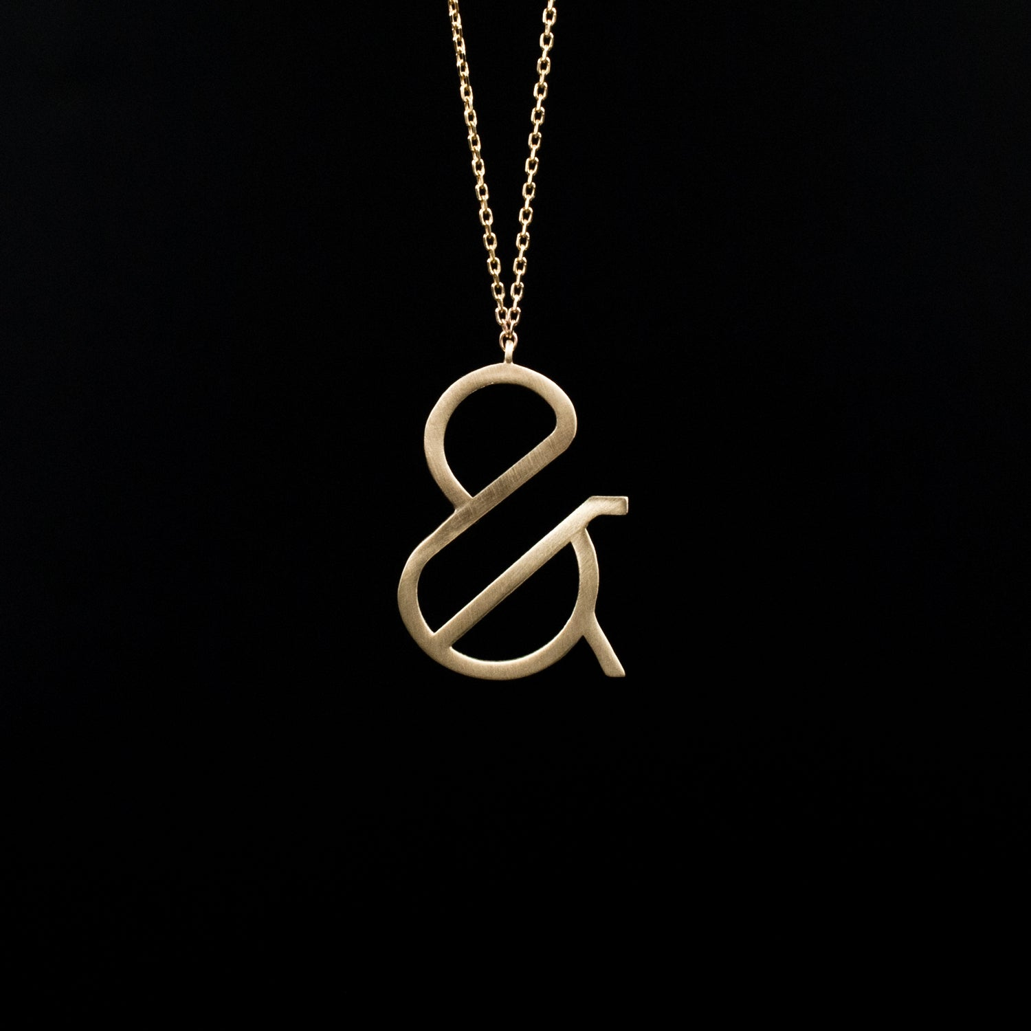 Minimal Ampersand Necklace - Designed by Moshik Nadav Fashion Typography