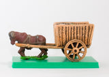 WAG16 Two wheeled open wicker crate with baggage and one Ox