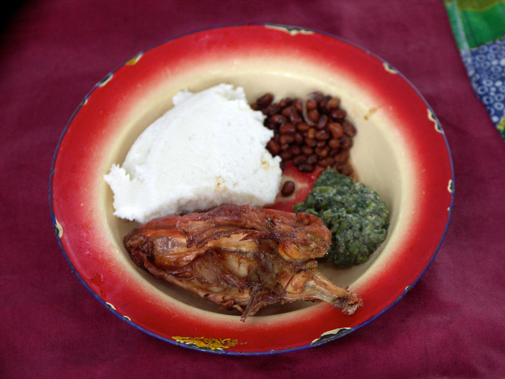 Pap (nshima) with Village Chicken and Pumpkin Leaves