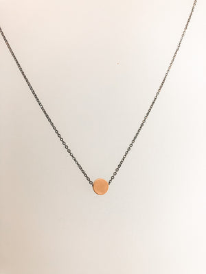Choose from a single yellow or rose gold plated dot delicately centered on an oxidized silver chain.