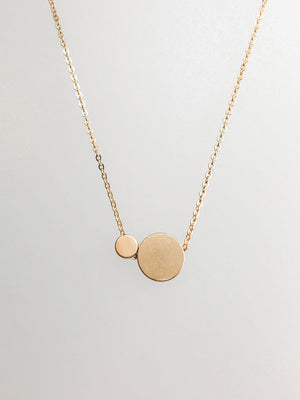 "Gold-plated ""polka dot"" necklace on an 18-inch gold chain."