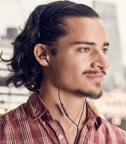 Guy with 1MORE Triple Driver In-Ear Headphones wellbots